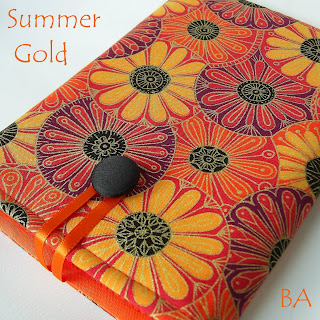 Stunning ladies' Kindle case, handmade in a multicoloured fabric of gold, yellow, orange, purple and black.
