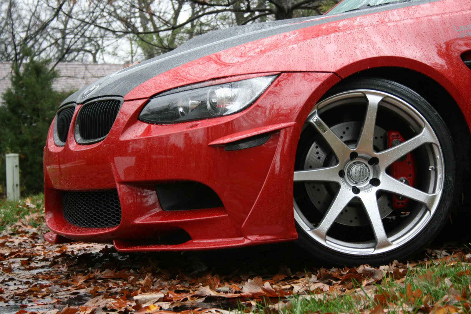 Again a side view of the front spoiler you will also notice that the signature ravenus studios brake caliper cover has been applied to the m3