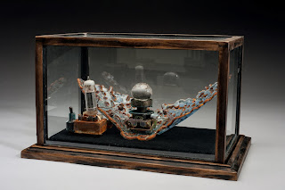 And then she invented a machine to make him change, Tempered Glass & Found Objects by Audrey Wilson