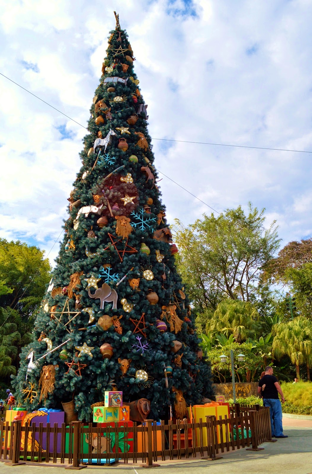 though animal kingdom doesnt have near as many christmas decorations as the other parks just outside the entrance is a 65 ft tall animal themed christmas - 65ft Christmas Tree