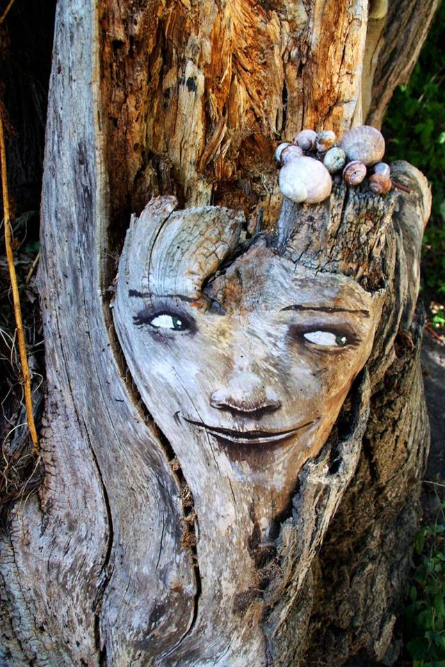 Painting eyes, faces and grimaces on the trees, by ornamenting and dressing them we emphasize our close and unique connection with nature.