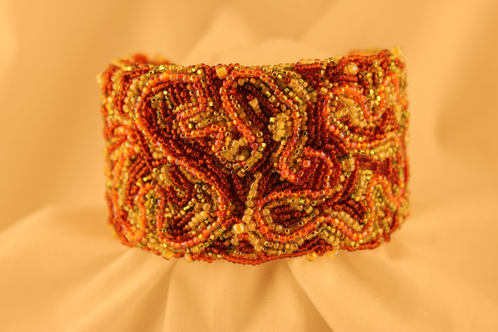 Swirling Rust, Orange, & Lime Seed Bead Cuff