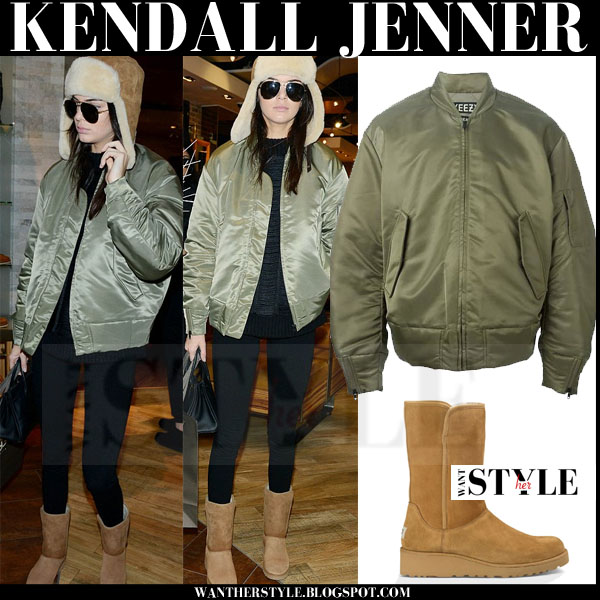 Kendall Jenner in green bomber yeezy jacket, brown UGG boots and brown traper hat what she wore winter outfit