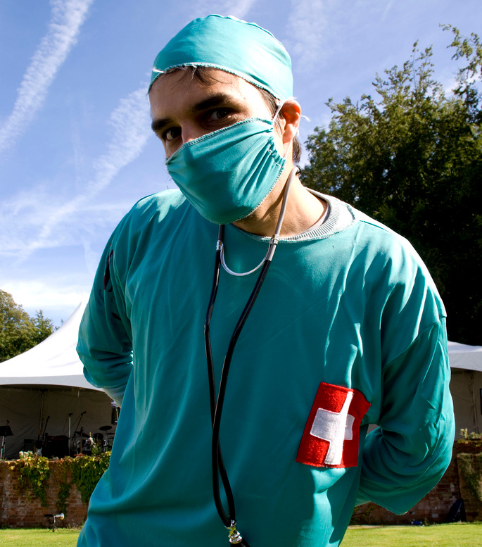 A man in a fancy dress surgeon's costume