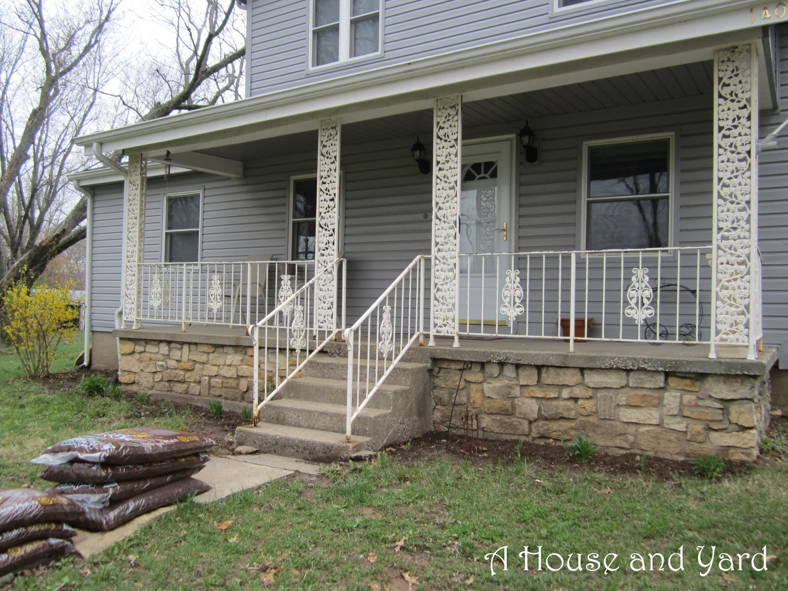 A house and yard flower beds galore for Flower beds in front of house