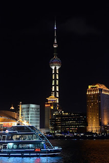 Pearl Tower with tour boat in Shanghai