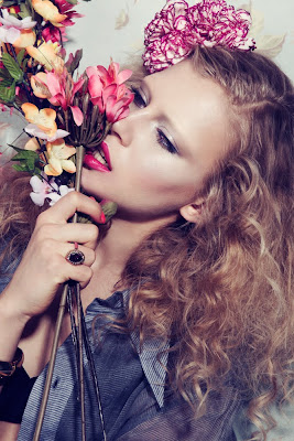fragrance campaign, model holding flowers, beauty fragrance