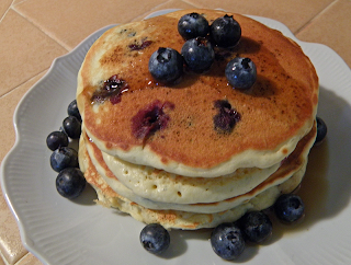 Stack of Blueberry Pancakes with extra Blueberries