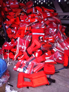 Life Jackets, Life Vests, used, second hand, reconditioned, balsa wood life jackets, cork life jackets, orange fabric, IRS, certified