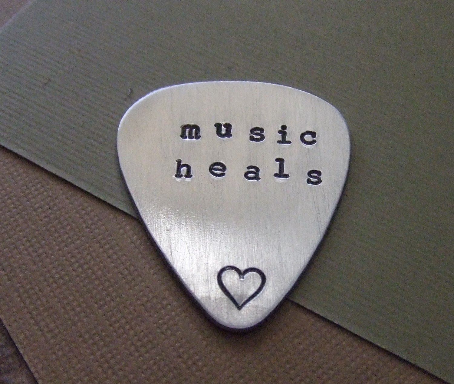 https://www.etsy.com/listing/162875996/personalized-guitar-pick-music-heals