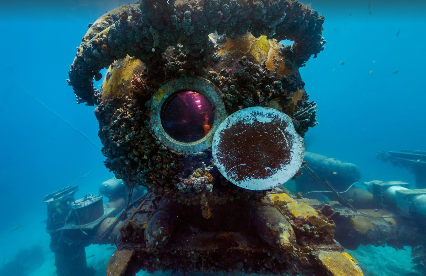 A cylinder-shaped object locked down to the ocean floor, located in Florida, called the Aquarius Reef Base which has wildlife roaming and living on it