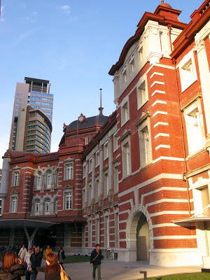 Tokyo Station against the Tokyo cityscape.
