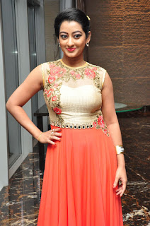 Tejaswini in lovely Orange Anarkali Suit at Cine Mahal audio launch