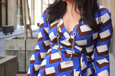 Diane Von Furstenberg Wrap Dress and St. John Necklace