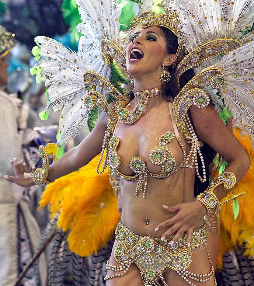 This school dancer do Peruche States, sings during a show before the carnival held in Sao Paulo, on March 4.