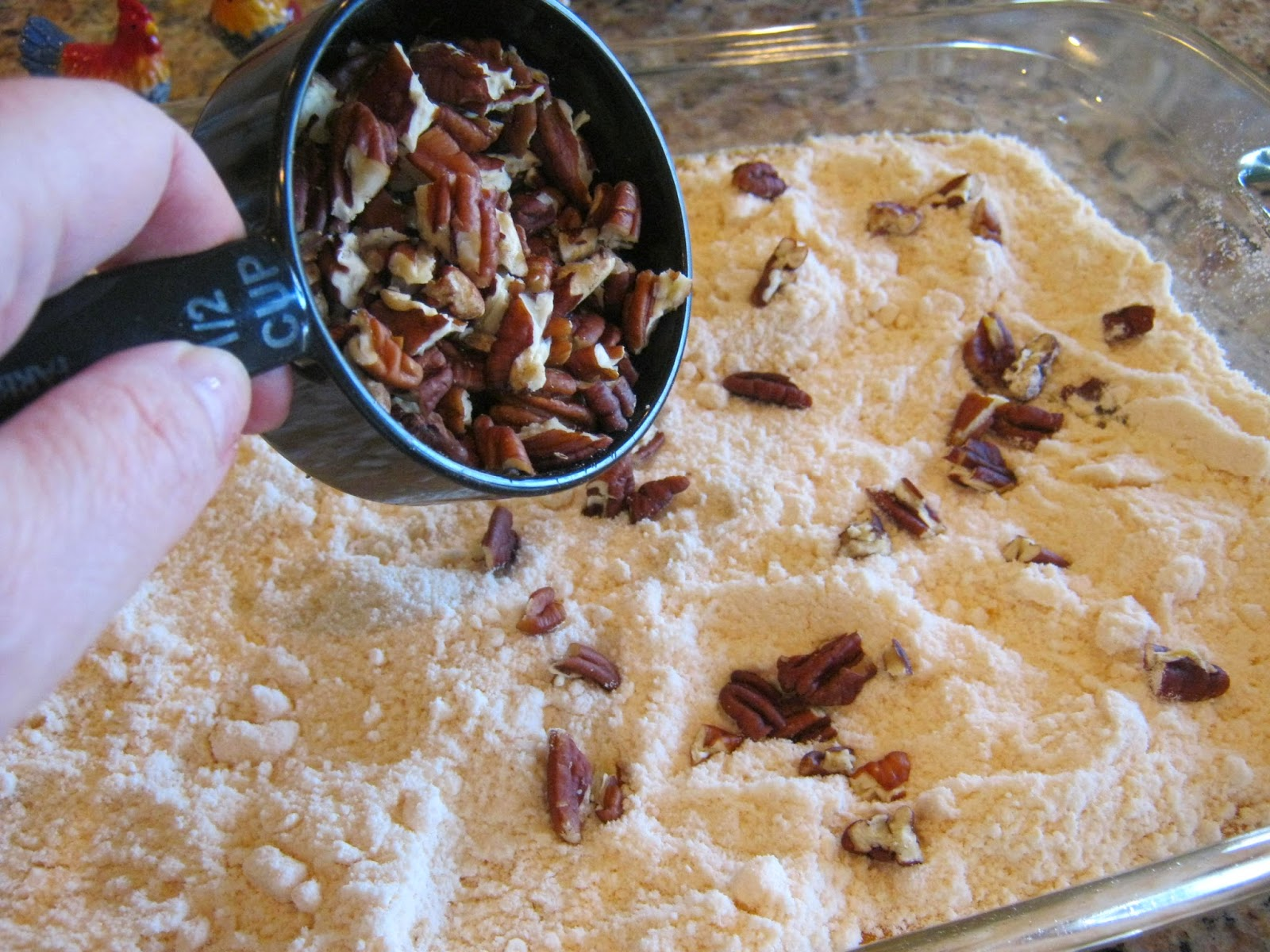 Add dry cake mix and pecans on top.