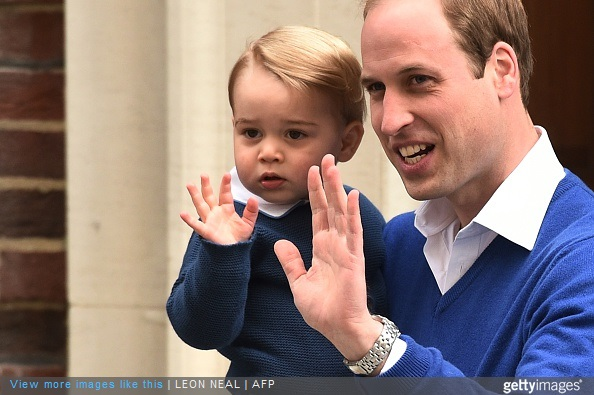Britain's Prince William, Duke of Cambridge, and his son Prince George of Cambridge wave as they return to the Lindo Wing at St Mary's Hospital in central London