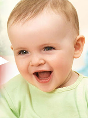 Little baby boy smiling and laughing picture to download