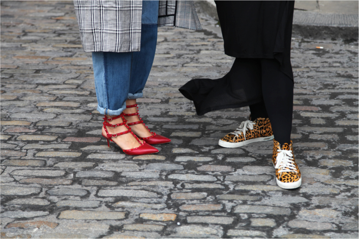 London Fashion Week street style valentino studded red heels and leopard sneakers