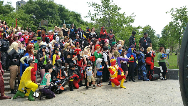 cosplayers on stairs Special Edition NYC DC Comics ensemble