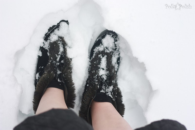 Feet in 1940s velvet and rabbit fur overboots, standing in about a foot of snow