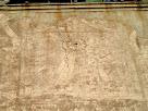 Detall, molt desdibuixat, del rellotge de sol de la façana de migdia de la Rectoria de Gaià
