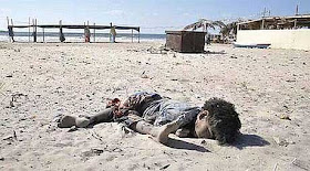 gaza_dead_boy_in_sand_460.jpg