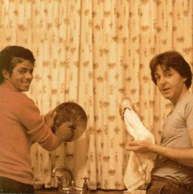 Paul McCarthy and Micheal Jackson doing the washing up.