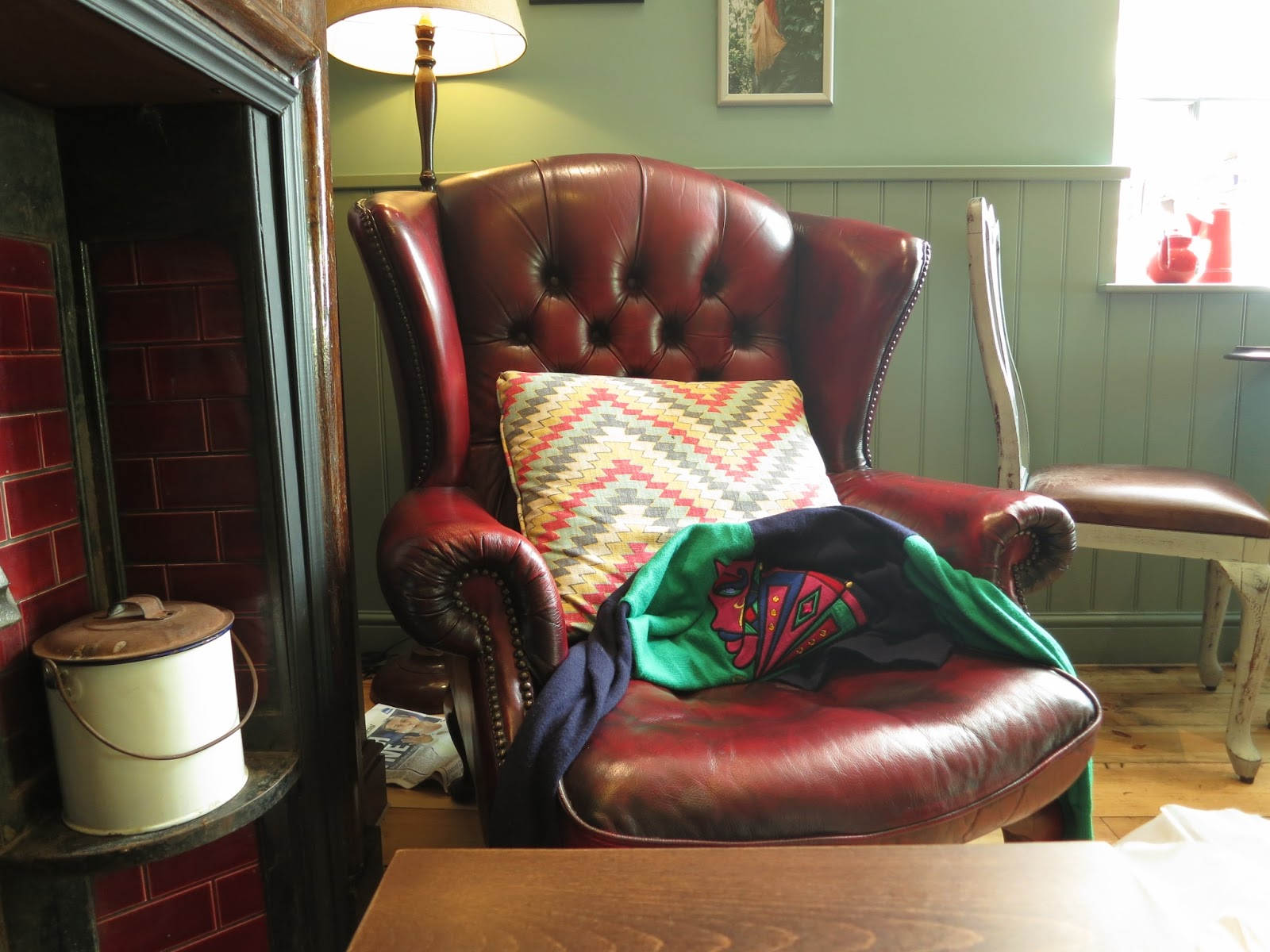Chair with brightly coloured cushion in cafe