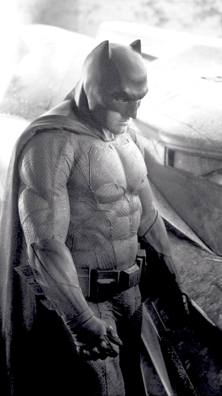"Director Zack Snyder revealed the black-and-white photo Tuesday on Twitter.         @ZackSnyder/Twitter     The first image of Ben Affleck as Batman in the upcoming Superman-Batman film has hit the web.  * This image has been altered to allow better exposure of the rest of the suit. Looks prety cool.   -GeekSummit  Director Zack Snyder unveiled the photo via Twitter on Tuesday, after teasing the day before that a Batman reveal of some sort was coming.  The monochromatic image features Affleck in the Batsuit with the new Batmobile at his side, as smoke looms in the background.     Affleck was cast in the role last August and the announcement was met with mixed reaction. (Snyder said at the time that Affleck's Batman would be ""older and wiser."") In response to Internet backlash, Affleck appeared on Late Night in September to address worries. ""They said just don't use the Internet for a couple of days,"" Affleck said at the time. ""I handle shit. I'm very tough. I saw the announcement, I look down on the first comment … the first one just goes, 'Nooooooooo!' ""  Snyder's Superman-Batman follow-up will return Henry Cavill, who starred in Man of Steel, as Superman. Gal Gadot will play Wonder Woman, Jesse Eisenberg has been cast as Lex Luthor, Jeremy Irons is set as Alfred and Ray Fisher will portray Victor Stone/Cyborg. Holly Hunter, Callan Mulvey and Tao Okamoto are also in the cast and will play newly created characters.  Affleck, Cavill and Gadot are expected to reprise their roles for the Justice League movie, which will also be directed by Snyder and have a 2017 release.  Warner Bros. has slated the Batman-Superman tentpole for May 6, 2016     Source: Hollywood Reporter"