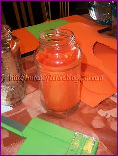 orange craft paper cut to size for pumpkin glass jar
