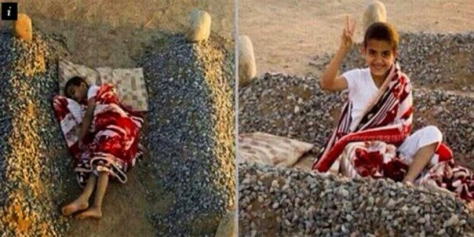 Tenyata Foto bocah Suriah yang Di Bilang tidur di pusara kedua orang tuanya itu hoax!