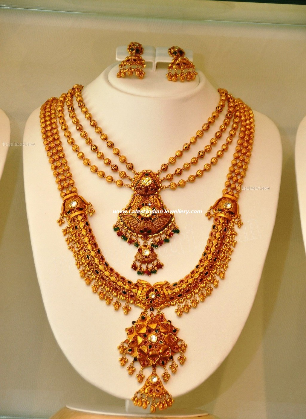 And contemporary gold jhumkas collection by khazana jewellery - Party Wear Designer Golden