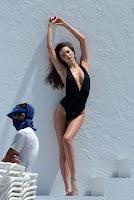Miranda Kerr cleavage in a black swimsuit