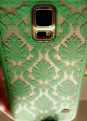 clear phone case with mint damask on gold phone