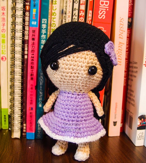 crocheted-girl-in-plaits-amigurumi