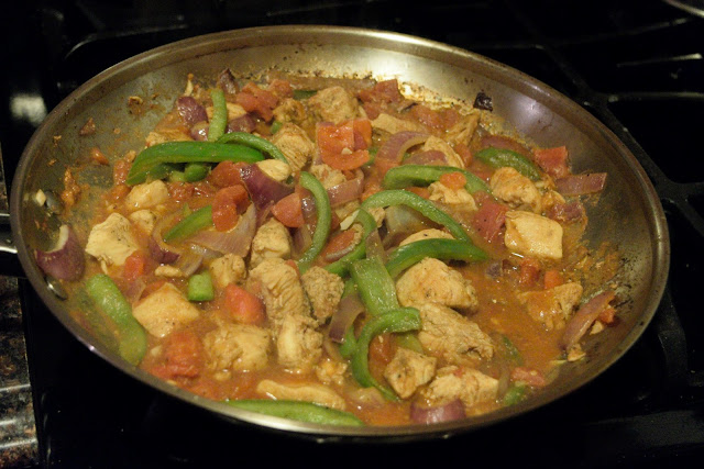 The chicken fajita pasta simmering in a skillet.