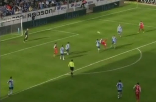 Kortrijk player Dalibor Veselinović shoots to score with a spectacular overhead-kick against Gent