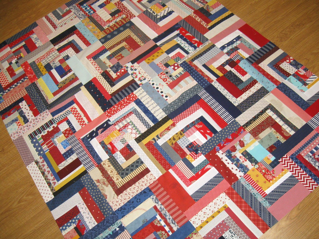 Happy quilting scrappy log cabin quilt top