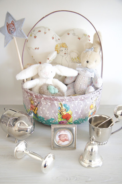 Baby silver collection, rattles, bells, piggybank, stuffed animals; Nursery in the Nest; Nora's Nest