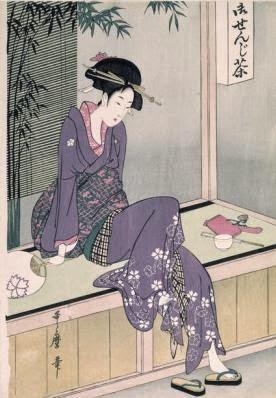 donna seduta sola e con rassegnazione in veranda