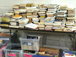 stacks books from Occupy Wall Street library