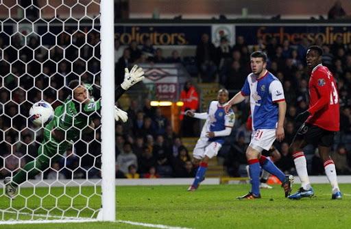 Manchester United player Antonio Valencia scores past Blackburn goalkeeper Paul Robinson
