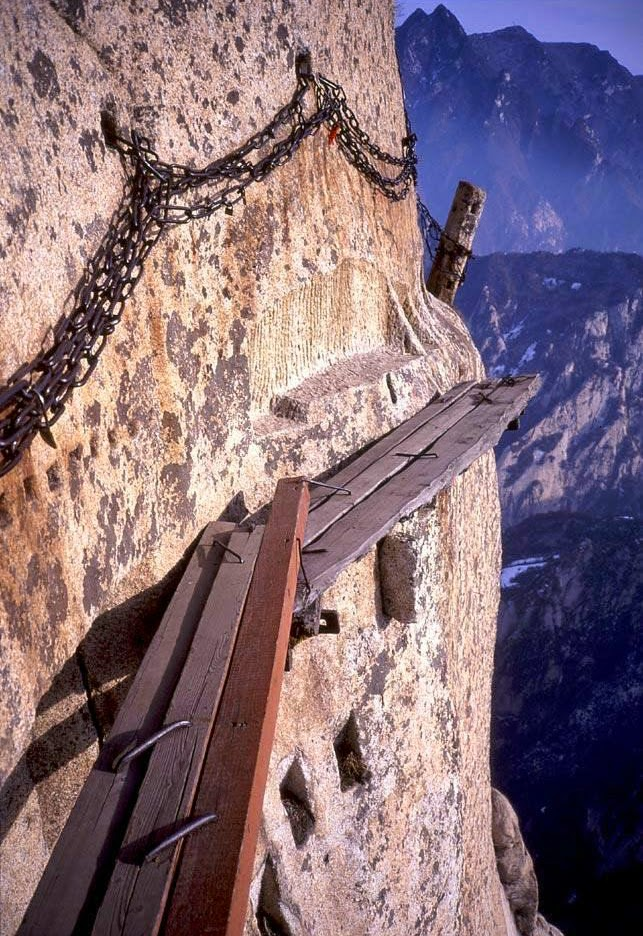 these planks are put together to bridge the gaps of the mountain trail