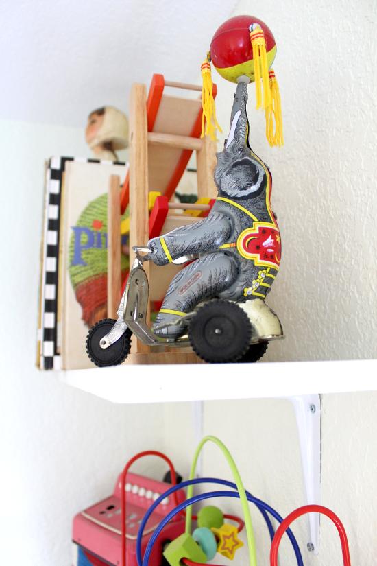 Tin elephant on bicycle