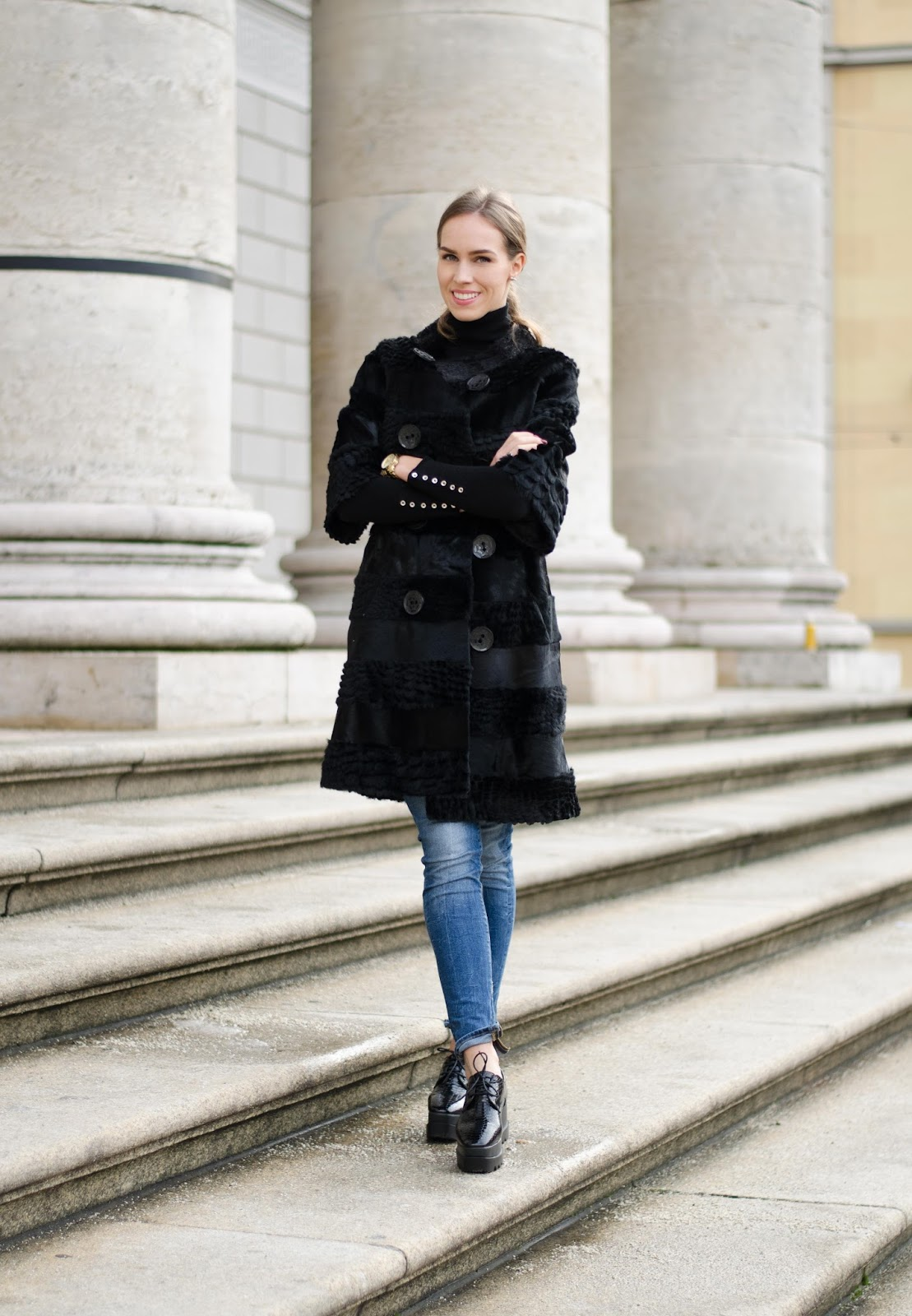 kristjaana mere black fur coat blue jeans black platform shoes