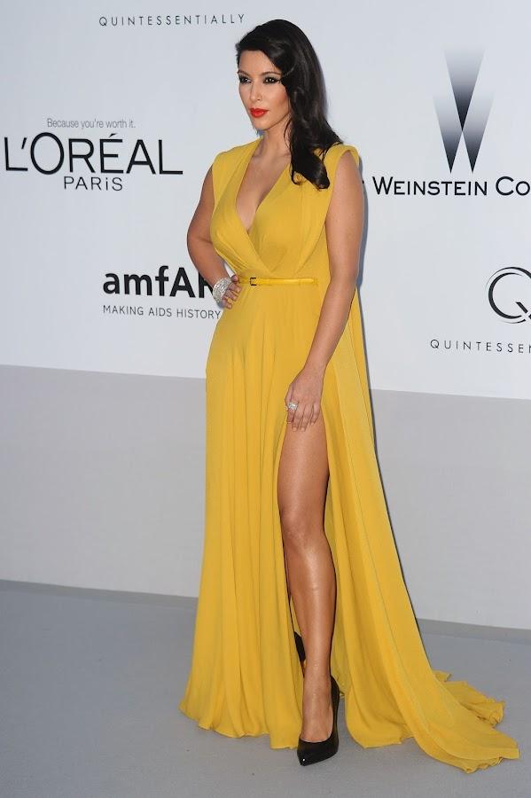 Kim Kardashian strikes a pose in a yellow dress