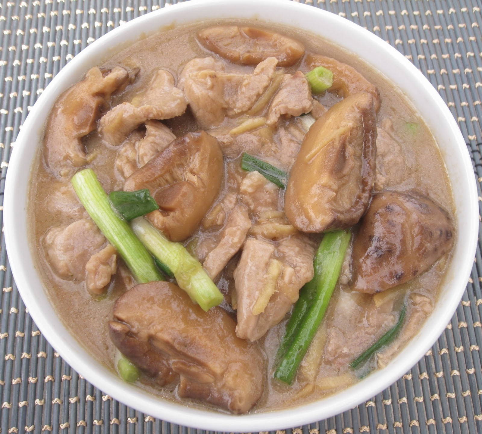 Asian pork with scallions and mushrooms