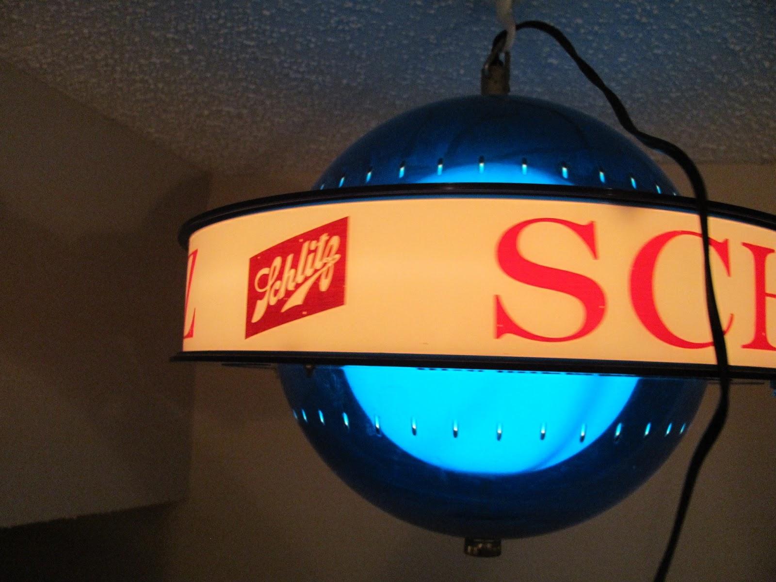 Blue Schlitz spinning globe light in action in a dark room