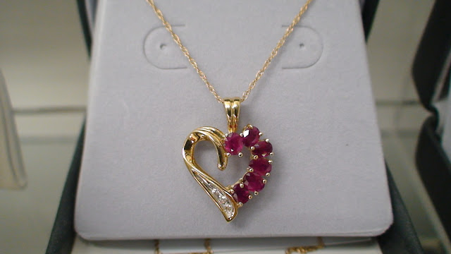 10k heart pendant with diamond and ruby a unique boutique put a smile on her face with this lovely 10k heart shaped diamond and ruby pendant save 7000 call toll free 888 942 0030 aloadofball Image collections
